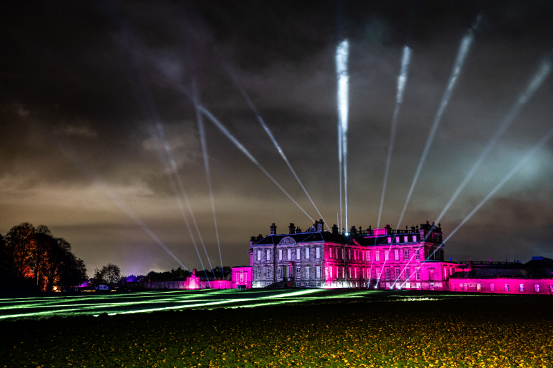 Stately home Hopetoun House illuminated in the dark with pink, purple and whitelights