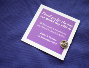 "Purple card with text, ""Thank you for sharing our special day with us. We have made a donation on your behalf to Scottish Autism. David and Simone 1st September 2018"""